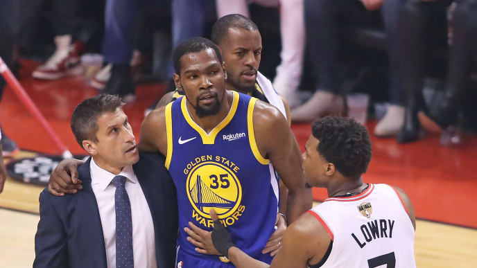 TORONTO,ONTARIO - JUNE 10:  Kyle Lowry #7 of the Toronto Raptors consoles and injured Kevin Durant #35 of the Golden State Warriors during Game Five of the 2019 NBA Finals at Scotiabank Arena on June 10, 2019 in Toronto, Canada. NOTE TO USER: User expressly acknowledges and agrees that, by downloading and or using this photograph, User is consenting to the terms and conditions of the Getty Images License Agreement. (Photo by Claus Andersen/Getty Images)