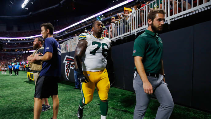 ATLANTA, GA - SEPTEMBER 17:  Mike Daniels #76 of the Green Bay Packers walks off the field during the first half against the Atlanta Falcons at Mercedes-Benz Stadium on September 17, 2017 in Atlanta, Georgia.  (Photo by Kevin C. Cox/Getty Images)