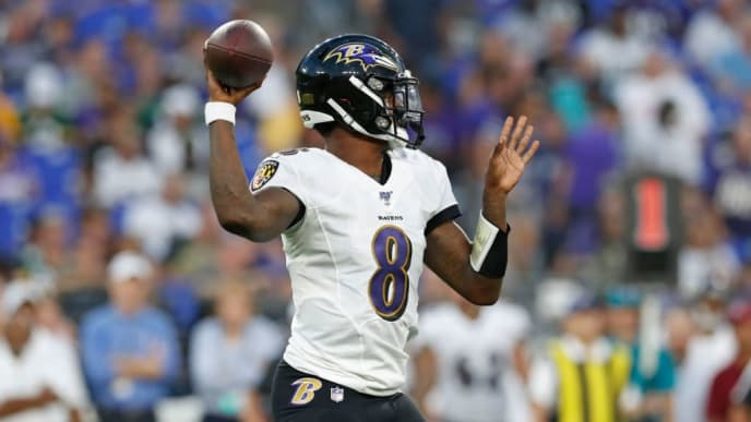 BALTIMORE, MARYLAND - AUGUST 15: Lamar Jackson #8 of the Baltimore Ravens throws the ball in the first half of a preseason game against the Green Bay Packers at M&T Bank Stadium on August 15, 2019 in Baltimore, Maryland. (Photo by Todd Olszewski/Getty Images)