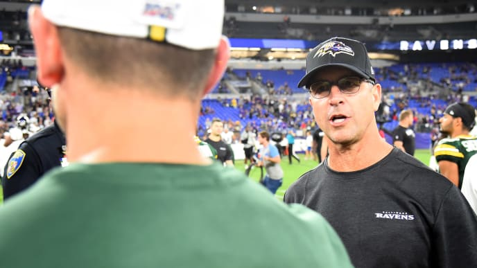 BALTIMORE, MD - AUGUST 15: Head coach John Harbaugh of the Baltimore Ravens speaks with head coach Matt LaFleur of the Green Bay Packers after a preseason game at M&T Bank Stadium on August 15, 2019 in Baltimore, Maryland. (Photo by Will Newton/Getty Images)