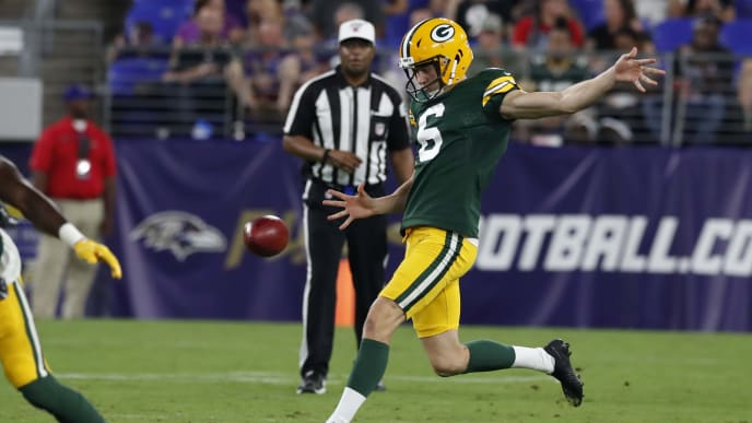 BALTIMORE, MARYLAND - AUGUST 15: J.K. Scott #6 of the Green Bay Packers punts the ball in the second half of a preseason game against the Baltimore Ravens at M&T Bank Stadium on August 15, 2019 in Baltimore, Maryland. (Photo by Todd Olszewski/Getty Images)