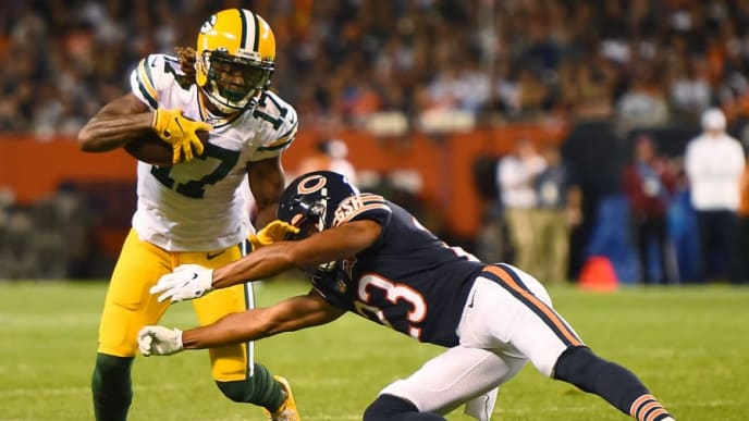 CHICAGO, ILLINOIS - SEPTEMBER 05:  Davante Adams #17 of the Green Bay Packers avoids a tackle by Kyle Fuller #23 of the Chicago Bears during the second quarter at Soldier Field on September 05, 2019 in Chicago, Illinois. (Photo by Stacy Revere/Getty Images)