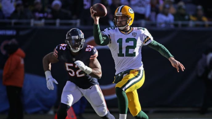 CHICAGO, IL - DECEMBER 16:  Aaron Rodgers #12 of the Green Bay Packers tries to throw while being chased by Khalil Mack #52 of the Chicago Bears at Soldier Field on December 16, 2018 in Chicago, Illinois.  (Photo by Jonathan Daniel/Getty Images)