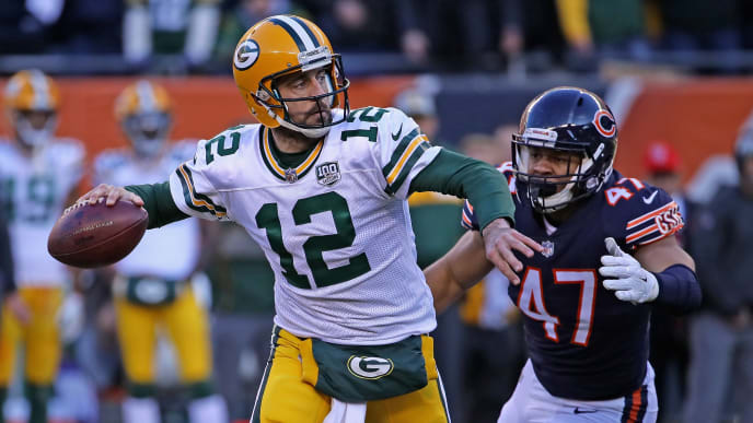 CHICAGO, IL - DECEMBER 16:  Aaron Rodgers #12 of the Green Bay Packers passes as Isaiah Irving #47 of the Chicago Bears closes in at Soldier Field on December 16, 2018 in Chicago, Illinois.The Bears defeated the Packers 24-17.  (Photo by Jonathan Daniel/Getty Images)