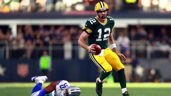 ARLINGTON, TX - OCTOBER 08:  Aaron Rodgers #12 of the Green Bay Packers scrambles with the ball against David Irving #95 of the Dallas Cowboys in the fourth quarter at AT&T Stadium on October 8, 2017 in Arlington, Texas.  (Photo by Tom Pennington/Getty Images)