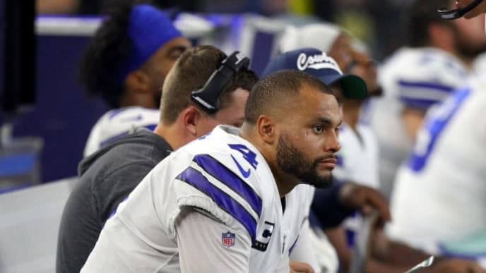 ARLINGTON, TEXAS - OCTOBER 06: Dak Prescott #4 of the Dallas Cowboys sits on the bench in the fourth quarter against the Green Bay Packers at AT&T Stadium on October 06, 2019 in Arlington, Texas. (Photo by Richard Rodriguez/Getty Images)
