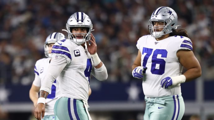 ARLINGTON, TEXAS - OCTOBER 06:  Dak Prescott #4 of the Dallas Cowboys and Xavier Su'a-Filo #76 of the Dallas Cowboys at AT&T Stadium on October 06, 2019 in Arlington, Texas. (Photo by Ronald Martinez/Getty Images)