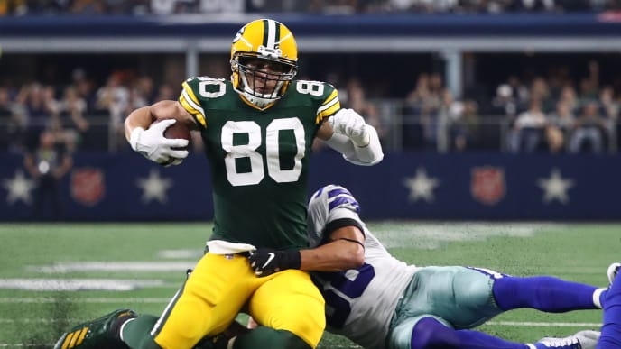 ARLINGTON, TEXAS - OCTOBER 06: Jimmy Graham #80 of the Green Bay Packers is tackled by Jeff Heath #38 of the Dallas Cowboys in the game at AT&T Stadium on October 06, 2019 in Arlington, Texas. (Photo by Ronald Martinez/Getty Images)