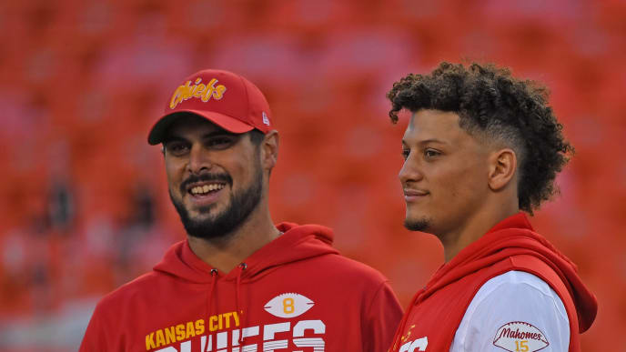 KANSAS CITY, MO - OCTOBER 27:  Quarterbacks Patrick Mahomes #15 and quarterback Matt Moore #8 of the of the Kansas City Chiefs look on during pre-game workouts prior to a game against the Green Bay Packers at Arrowhead Stadium on October 27, 2019 in Kansas City, Missouri. (Photo by Peter G. Aiken/Getty Images)