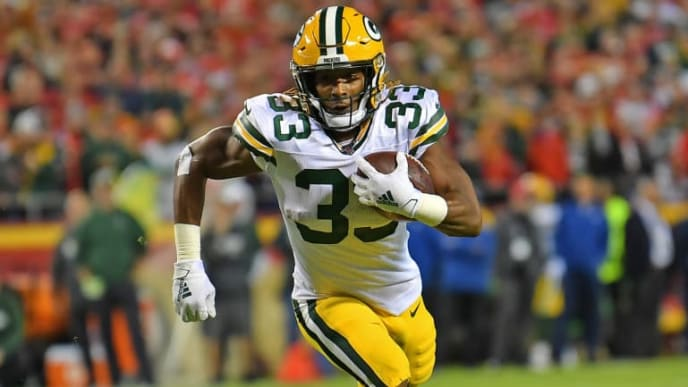 KANSAS CITY, MO - OCTOBER 27:  Running back Aaron Jones #33 of the Green Bay Packers runs up field against the Kansas City Chiefs during the first half at Arrowhead Stadium on October 27, 2019 in Kansas City, Missouri. (Photo by Peter G. Aiken/Getty Images)