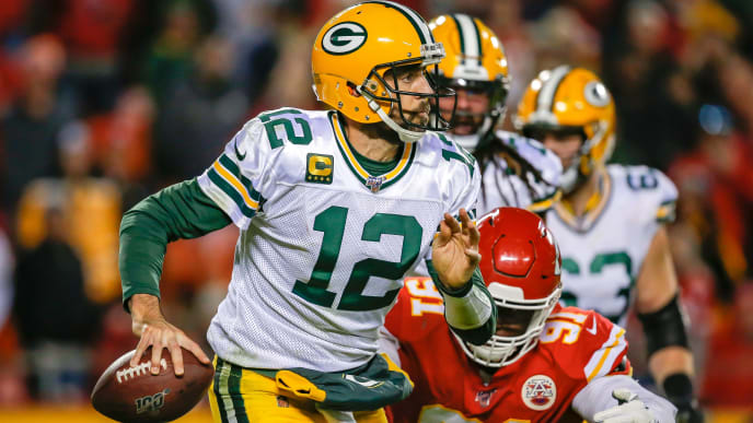 KANSAS CITY, MO - OCTOBER 27: Aaron Rodgers #12 of the Green Bay Packers scrambles away from defensive pressure by Derrick Nnadi #91 of the Kansas City Chiefs in the third quarter at Arrowhead Stadium on October 27, 2019 in Kansas City, Missouri. (Photo by David Eulitt/Getty Images)