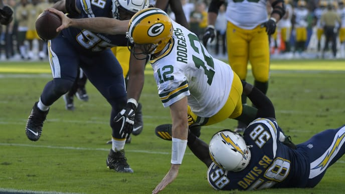 CARSON, CA - NOVEMBER 03: Aaron Rodgers #12 of the Green Bay Packers dives past Thomas Davis #58 and Jerry Tillery #99 of the Los Angeles Chargers for a two-point conversion in the fourth quarter at Dignity Health Sports Park on November 3, 2019 in Carson, California. (Photo by John McCoy/Getty Images) Chargers won 26-11.