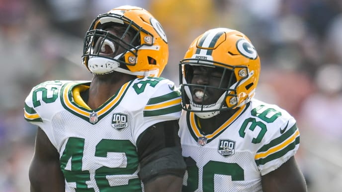 LOS ANGELES, CA - OCTOBER 28: Linebacker Oren Burks #42 of the Green Bay Packers celebrates after making a tackle with defensive back Raven Greene #36 in the first quarter at Los Angeles Memorial Coliseum on October 28, 2018 in Los Angeles, California. (Photo by John McCoy/Getty Images)