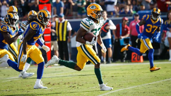 LOS ANGELES, CA - OCTOBER 28: Running back Aaron Jones #33 of the Green Bay Packers scores a touchdown at the end of the third quarter against the Los Angeles Rams at Los Angeles Memorial Coliseum on October 28, 2018 in Los Angeles, California. (Photo by Joe Robbins/Getty Images)