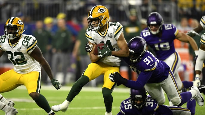 MINNEAPOLIS, MN - NOVEMBER 25: Trevor Davis #11 of the Green Bay Packers is tackled with the ball in the first quarter of the game against the Minnesota Vikings at U.S. Bank Stadium on November 25, 2018 in Minneapolis, Minnesota. (Photo by Hannah Foslien/Getty Images)