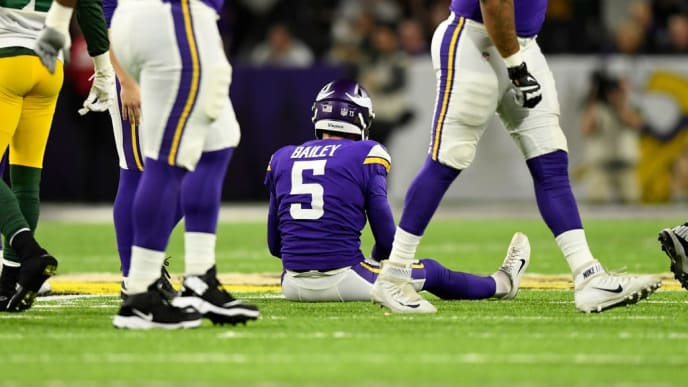 MINNEAPOLIS, MN - NOVEMBER 25: Dan Bailey #5 of the Minnesota Vikings sits on the field after missing a field goal at the end of the second quarter of the game against the Green Bay Packers at U.S. Bank Stadium on November 25, 2018 in Minneapolis, Minnesota. (Photo by Hannah Foslien/Getty Images)