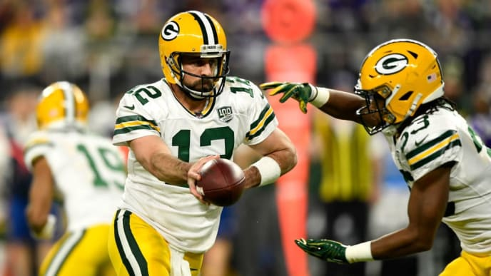 MINNEAPOLIS, MN - NOVEMBER 25: Aaron Rodgers #12 of the Green Bay Packers hands the ball off to Aaron Jones #33 in the first quarter of the game against the Minnesota Vikings at U.S. Bank Stadium on November 25, 2018 in Minneapolis, Minnesota. (Photo by Hannah Foslien/Getty Images)