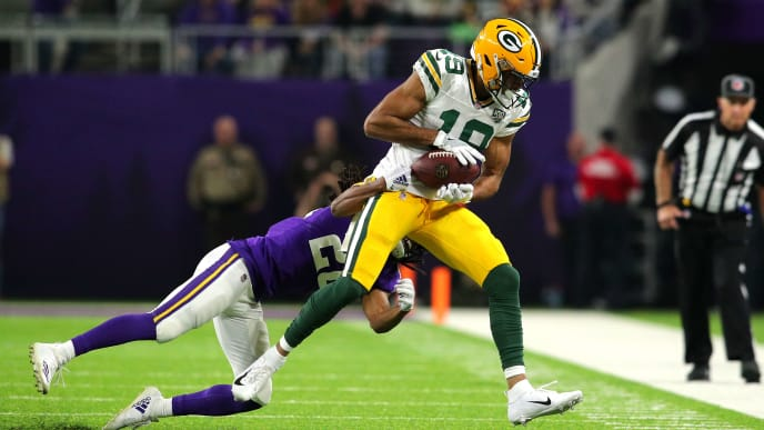 MINNEAPOLIS, MN - NOVEMBER 25: Equanimeous St. Brown #19 of the Green Bay Packers catches the ball as he is hit by Trae Waynes #26 of the Minnesota Vikings in the second quarter of the game at U.S. Bank Stadium on November 25, 2018 in Minneapolis, Minnesota. (Photo by Adam Bettcher/Getty Images)