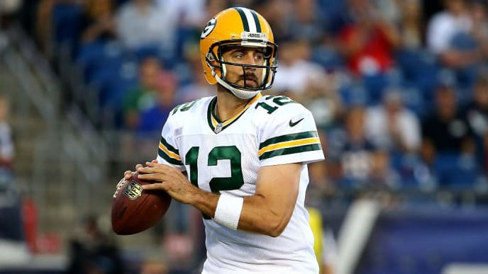 FOXBORO, MA - AUGUST 13:  Aaron Rodgers #12 of the Green Bay Packers drops back to pass in the first quarter against the New England Patriots during a preseason game at Gillette Stadium on August 13, 2015 in Foxboro, Massachusetts.  (Photo by Maddie Meyer/Getty Images)