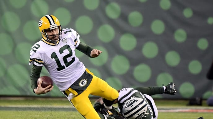 EAST RUTHERFORD, NEW JERSEY - DECEMBER 23: Aaron Rodgers #12 of the Green Bay Packers is tackled by Brandon Copeland #51 of the New York Jets during overtime at MetLife Stadium on December 23, 2018 in East Rutherford, New Jersey. The Packers defeated the Jets 44-38 in overtime. (Photo by Steven Ryan/Getty Images)