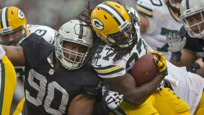 OAKLAND, CA - DECEMBER 20:  Running back Eddie Lacy #27 of the Green Bay Packers come square up against defensive tackle Dan Williams #90 of the Oakland Raiders in the second quarter on December 20, 2015 at O.co Coliseum in Oakland, California.  The Packers won 30-20. (Photo by Brian Bahr/Getty Images)
