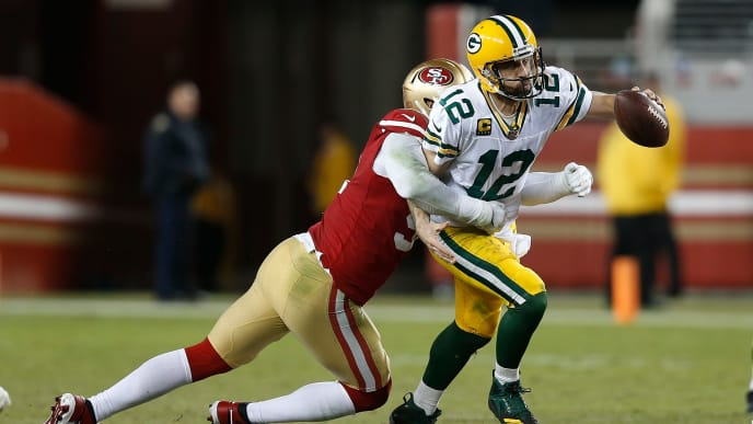 SANTA CLARA, CALIFORNIA - NOVEMBER 24: Aaron Rodgers #12 of the Green Bay Packers is sacked by Arik Armstead #91 of the San Francisco 49ers in the third quarter at Levi's Stadium on November 24, 2019 in Santa Clara, California. (Photo by Lachlan Cunningham/Getty Images)