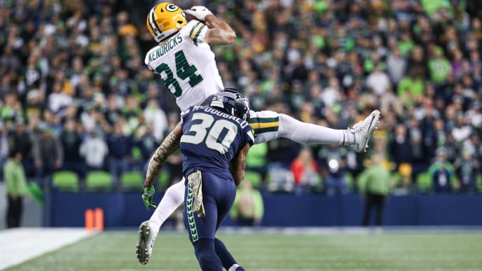 SEATTLE, WA - NOVEMBER 15: Lance Kendricks #84 of the Green Bay Packers catches the ball over Bradley McDougald #30 of the Seattle Seahawks in the second quarter at CenturyLink Field on November 15, 2018 in Seattle, Washington. (Photo by Abbie Parr/Getty Images)