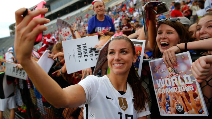 BIRMINGHAM, AL - SEPTEMBER 20:  Alex Morgan #13 of the United States of America takes a photo for fans after their 8-0 win over Haiti during the US Women's 2015 World Cup victory tour match at Legion Field on September 20, 2015 in Birmingham, Alabama.  (Photo by Kevin C. Cox/Getty Images)
