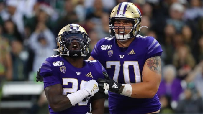 SEATTLE, WASHINGTON - SEPTEMBER 14: Richard Newton #28 celebrates with Jared Hilbers #70 of the Washington Huskies after scoring a one yard touchdown against the Hawaii Rainbow Warriors in the fourth quarter during their game at Husky Stadium on September 14, 2019 in Seattle, Washington. (Photo by Abbie Parr/Getty Images)