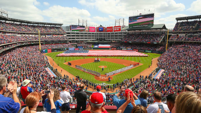 ARLINGTON, TX - MARCH 29:  Fans cheer after the playing of the National Anthem before the Opening Day baseball game between the Houston Astros and the Texas Rangers at Globe Life Park in Arlington on March 29, 2018 in Arlington, Texas.  (Photo by Richard Rodriguez/Getty Images)