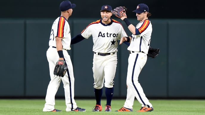 BALTIMORE, MD - AUGUST 09:  Michael Brantley #23, George Springer #4 and Josh Reddick #22 of the Houston Astros celebrate after a 3-2 victory against the Baltimore Orioles at Oriole Park at Camden Yards on August 9, 2019 in Baltimore, Maryland.  (Photo by Greg Fiume/Getty Images)