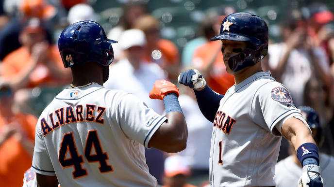 BALTIMORE, MD - AUGUST 11: Carlos Correa #1 of the Houston Astros celebrates with Yordan Alvarez #44 after hitting a three-run home run during the second inning against the Baltimore Orioles at Oriole Park at Camden Yards on August 11, 2019 in Baltimore, Maryland. (Photo by Will Newton/Getty Images)