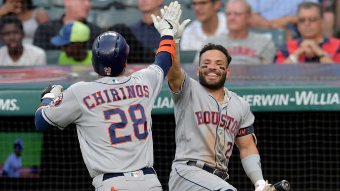 CLEVELAND, OHIO - JULY 30: Robinson Chirinos #28 celebrates with Jose Altuve #27 of the Houston Astros after Chirinos scored on a solo homer during the fifth inning against the Cleveland Indians at Progressive Field on July 30, 2019 in Cleveland, Ohio. (Photo by Jason Miller/Getty Images)