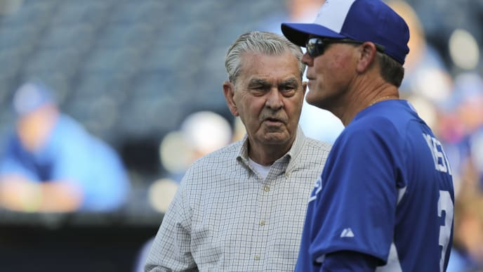 KANSAS CITY, MO - JUNE 7:  Manager Ned Yost #3 of the Kansas City Royals talks with owner David Glass prior to a game against the Houston Astros at Kauffman Stadium on June 7, 2013 in Kansas City, Missouri. (Photo by Ed Zurga/Getty Images)
