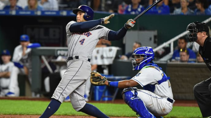 KANSAS CITY, MISSOURI - SEPTEMBER 13:  George Springer #4 of the Houston Astros hits a three-run home run against the Kansas City Royals in the ninth inning at Kauffman Stadium on September 13, 2019 in Kansas City, Missouri. (Photo by Ed Zurga/Getty Images)