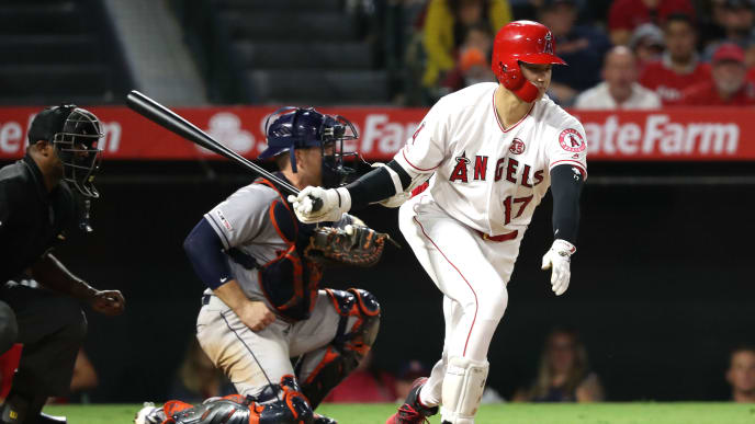 ANAHEIM, CALIFORNIA - JULY 18:  Shohei Ohtani #17 of the Los Angeles Angels of Anaheim strikes out to end the game as Max Stassi #12 of the Houston Astros looks on during the ninth inning of a game at Angel Stadium of Anaheim on July 18, 2019 in Anaheim, California. (Photo by Sean M. Haffey/Getty Images)