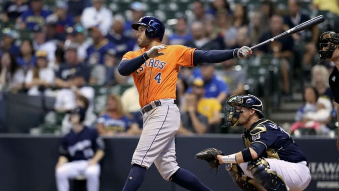 MILWAUKEE, WISCONSIN - SEPTEMBER 02:  George Springer #4 of the Houston Astros hits a home run in the tenth inning against the Milwaukee Brewers at Miller Park on September 02, 2019 in Milwaukee, Wisconsin. (Photo by Dylan Buell/Getty Images)