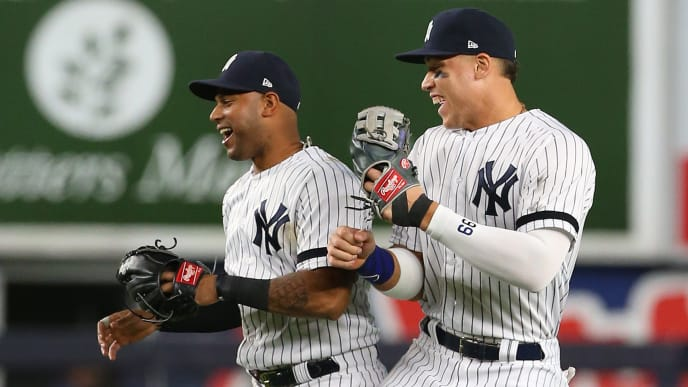 NEW YORK, NY - JUNE 22: Aaron Hicks #31 and Aaron Judge #99 of the New York Yankees celebrate after defeateing the Houston Astros 7-5 during a baseball game at Yankee Stadium on June 22, 2019 in the Bronx borough of New York City. (Photo by Rich Schultz/Getty Images)