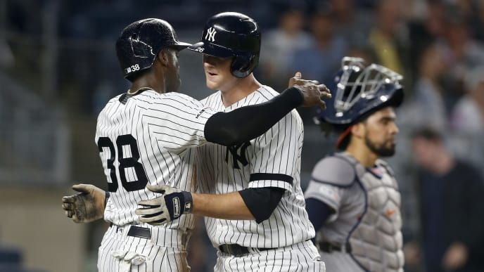 NEW YORK, NEW YORK - JUNE 20:   DJ LeMahieu #26 of the New York Yankees celebrates his fourth inning two run home run with teammate Cameron Maybin #38 as Robinson Chirinos #28 of the Houston Astros looks on at Yankee Stadium on June 20, 2019 in the Bronx borough of New York City. (Photo by Jim McIsaac/Getty Images)