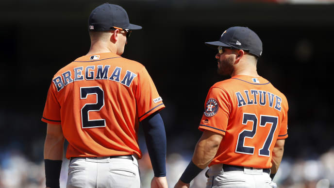 NEW YORK, NEW YORK - JUNE 23:   Alex Bregman #2 and Jose Altuve #27 of the Houston Astros in action against the New York Yankees at Yankee Stadium on June 23, 2019 in New York City.  The Astros defeated the Yankees 9-4. (Photo by Jim McIsaac/Getty Images)