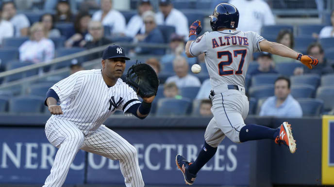 NEW YORK, NEW YORK - JUNE 21:   Edwin Encarnacion #30 of the New York Yankees makes the catch for an out to end the first inning against Jose Altuve #27 of the Houston Astros at Yankee Stadium on June 21, 2019 in New York City. (Photo by Jim McIsaac/Getty Images)