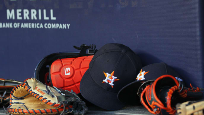 NEW YORK, NY - JUNE 22: New Era caps and gloves in the Houston Astros dugout during a baseball game against the New York Yankees at Yankee Stadium on June 22, 2019 in the Bronx borough of New York City. (Photo by Rich Schultz/Getty Images)