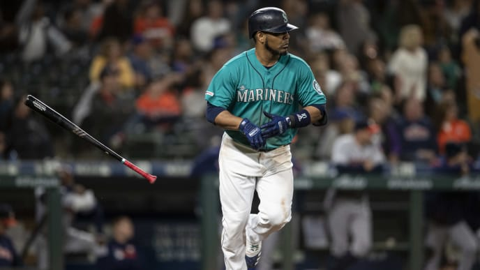 SEATTLE, WA - JUNE 5: Edwin Encarnacion #10 of the Seattle Mariners flips his bat after hitting a three-run home run off of relief pitcher Brady Rodgers #52 of the Houston Astros that also scored Mallex Smith #0 of the Seattle Mariners and Dylan Moore #25 during the sixth inning of a game at T-Mobile Park on June 5, 2019 in Seattle, Washington. (Photo by Stephen Brashear/Getty Images)