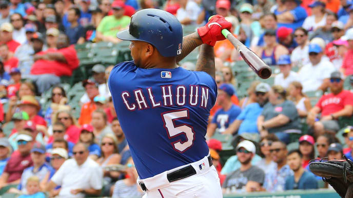ARLINGTON, TX - JULY 14: Willie Calhoun #5 of the Texas Rangers hits a single in the first inning  against the Houston Astros at Globe Life Park in Arlington on July 14, 2019 in Arlington, Texas. (Photo by Rick Yeatts/Getty Images)