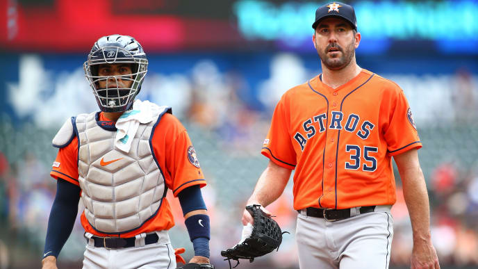 ARLINGTON, TX - JULY 14:  Catcher Robinson Chirinos #28 and Justin Verlander #35 of the Houston Astros walk to the dugout before the start of the game against the Texas Rangers at Globe Life Park in Arlington on July 14, 2019 in Arlington, Texas. (Photo by Rick Yeatts/Getty Images)