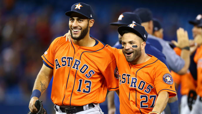 TORONTO, ON - SEPTEMBER 01:  Abraham Toro #13 and Jose Altuve #27 of the Houston Astros celebrate a no hitter by teammate Justin Verlander #35 at the end of the ninth inning during a MLB game against the Toronto Blue Jays at Rogers Centre on September 01, 2019 in Toronto, Canada.  (Photo by Vaughn Ridley/Getty Images)