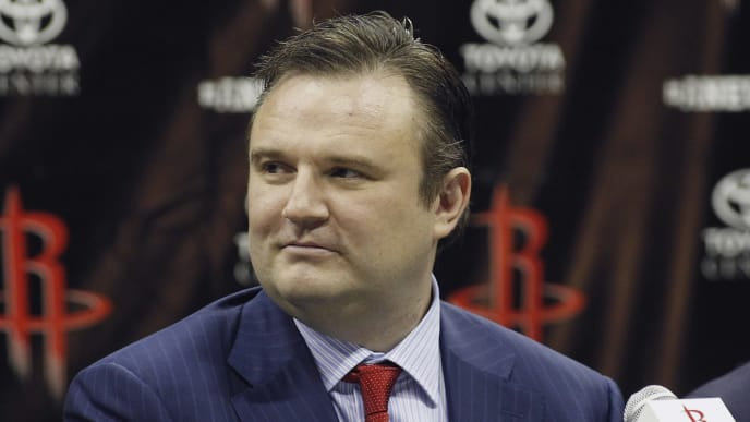 HOUSTON, TX - JULY 13: Houston Rockets general manager Daryl Morey listens as Dwight Howard is officially introduced as a Houston Rocket during a press conference on July 13, 2013 in Houston, Texas.  (Photo by Bob Levey/Getty Images)