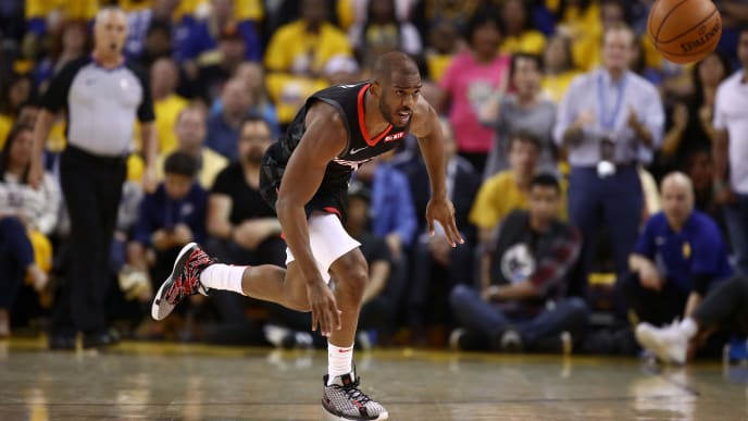 OAKLAND, CALIFORNIA - MAY 08:   Chris Paul #3 of the Houston Rockets goes for a loose ball against the Golden State Warriors during Game Five of the Western Conference Semifinals of the 2019 NBA Playoffs at ORACLE Arena on May 08, 2019 in Oakland, California.  NOTE TO USER: User expressly acknowledges and agrees that, by downloading and or using this photograph, User is consenting to the terms and conditions of the Getty Images License Agreement.  (Photo by Ezra Shaw/Getty Images)