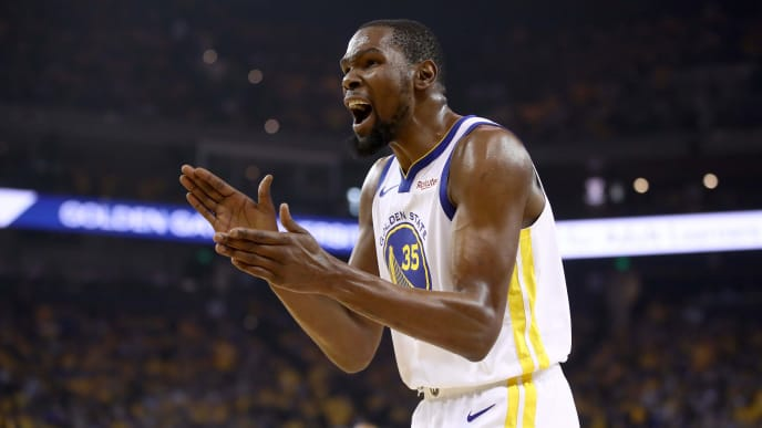 OAKLAND, CALIFORNIA - MAY 08:   Kevin Durant #35 of the Golden State Warriors reacts during their game against the Houston Rockets in Game Five of the Western Conference Semifinals of the 2019 NBA Playoffs at ORACLE Arena on May 08, 2019 in Oakland, California.  NOTE TO USER: User expressly acknowledges and agrees that, by downloading and or using this photograph, User is consenting to the terms and conditions of the Getty Images License Agreement.  (Photo by Ezra Shaw/Getty Images)
