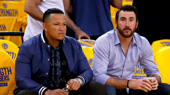 OAKLAND, CA - MAY 27:  (L-R) Miguel Cabrera and Justin Verlander of the Detroit Tigers watch warm ups before game five of the Western Conference Finals of the 2015 NBA Playoffs between the Houston Rockets and the Golden State Warriors at ORACLE Arena on May 27, 2015 in Oakland, California. NOTE TO USER: User expressly acknowledges and agrees that, by downloading and or using this photograph, user is consenting to the terms and conditions of Getty Images License Agreement.  (Photo by Ezra Shaw/Getty Images)